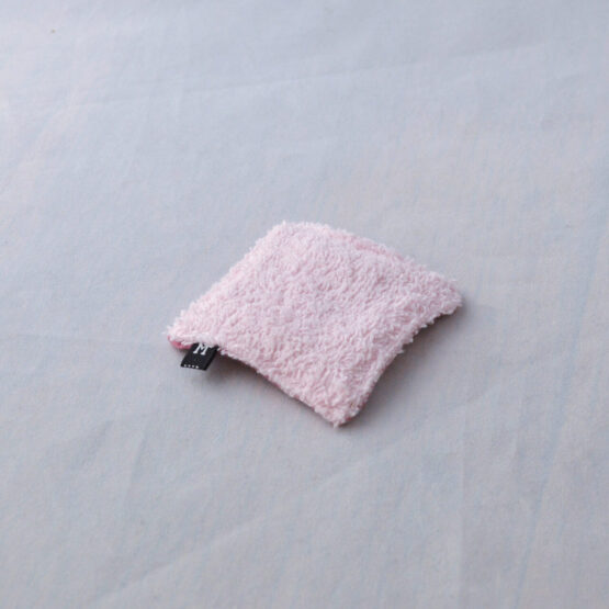 A reusable makeup wipe, front detail. In pink flannel, also available in blue flannel.