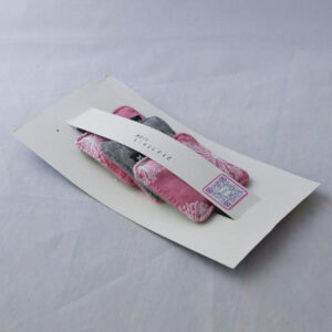 A pack of 3 reusable makeup wipes in their recycled packaging.