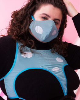 A close up of model Aimee wears the Cloud Nine harness and matching facemask.